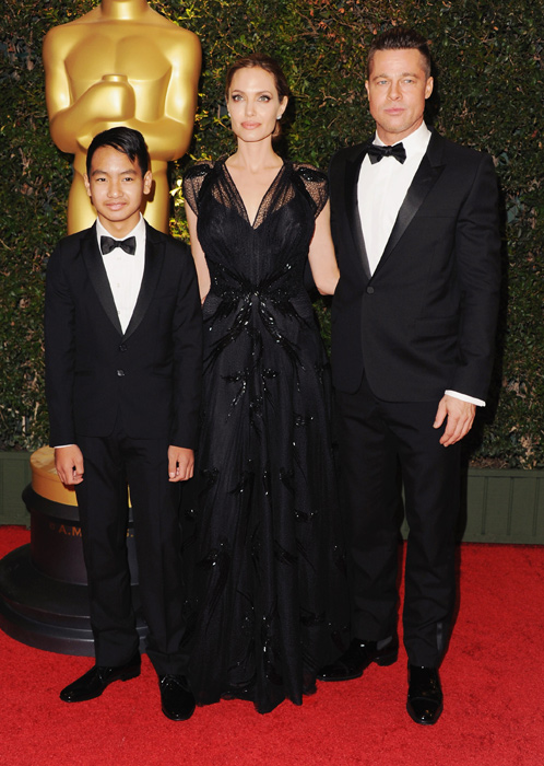 Maddox is all grown up as he makes red carpet debut with ...