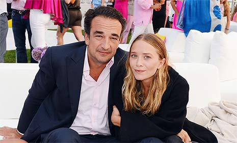Mary-Kate Olsen cuddles up to fiancé Olivier Sarkozy during rare public appearance