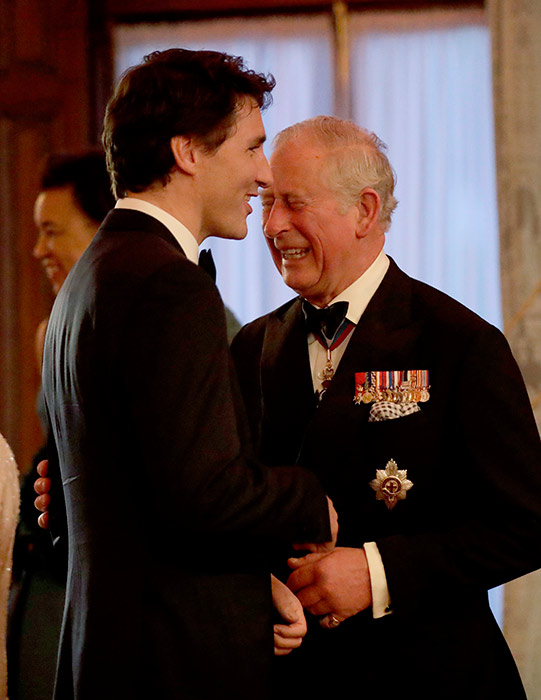 Justin Trudeau laughing with Prince charles