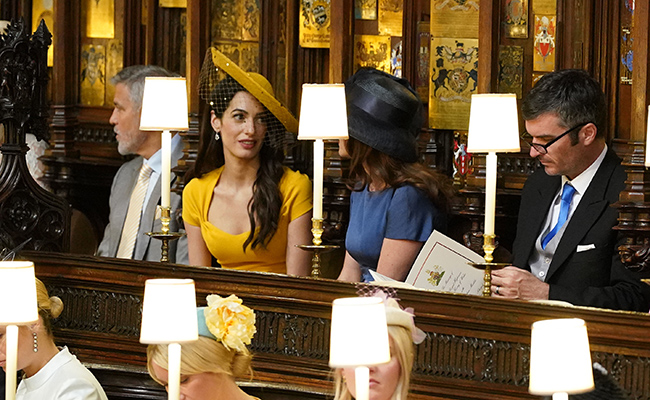 amal clooney sitting inside royal wedding