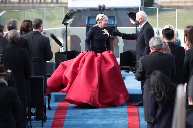 Lady Gaga surprises fans in a Hunger Games-esque dress at ...
