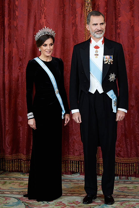 Queen Letizia of Spain wearing a long velvet dress and a tiara