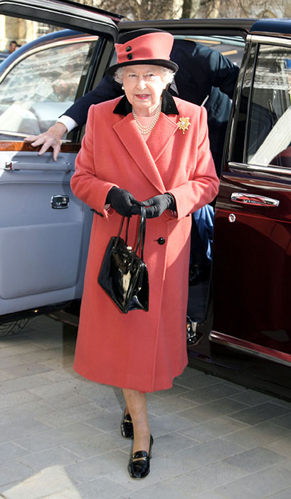 The Queen wearing a coral coat