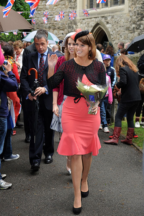 Princess Beatrice wearing a coral dress