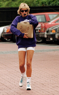 Princess Diana wearing trainers and socks with a purple sweatshirt and shorts