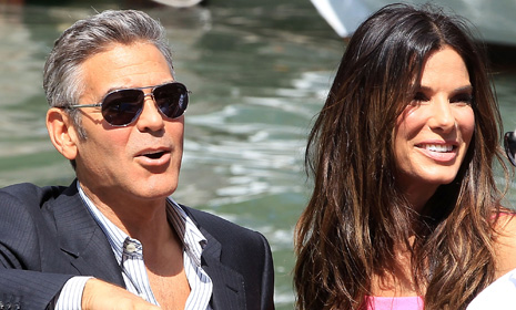 George Clooney, Sandra Bullock and her adorable son Louis arrive for Venice Film Festival