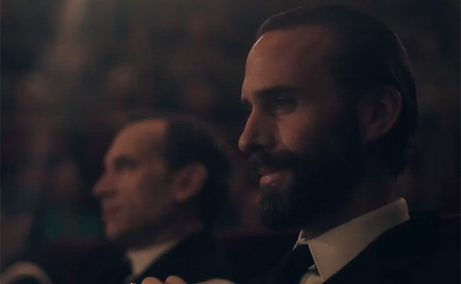 A close up on-screen shot of Joesph Fiennes as he is playing Commander Fred Waterford