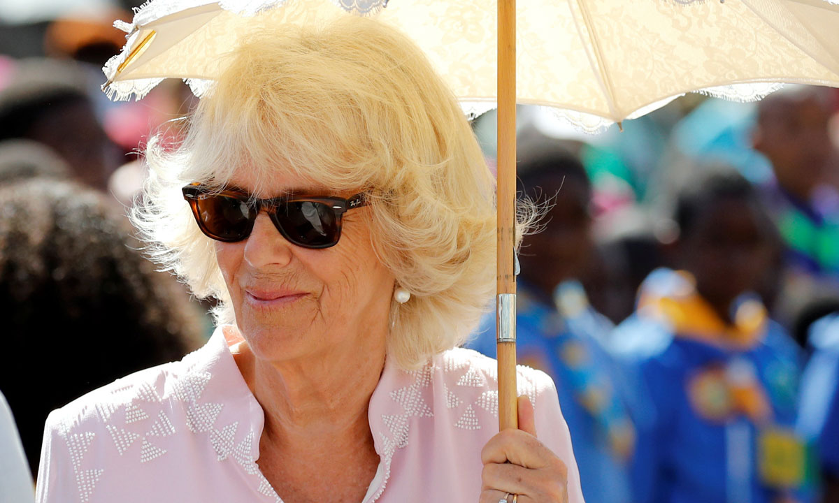 The Duchess of Cornwall looks cool in pink in St. Vincent with Prince Charles