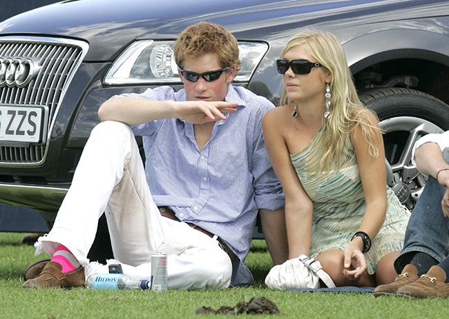 Prince Harry and and Chelsy Davy sitting on a lawn together