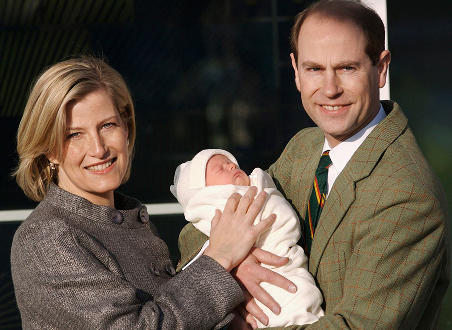 Baby James, Viscount Severn, with parents