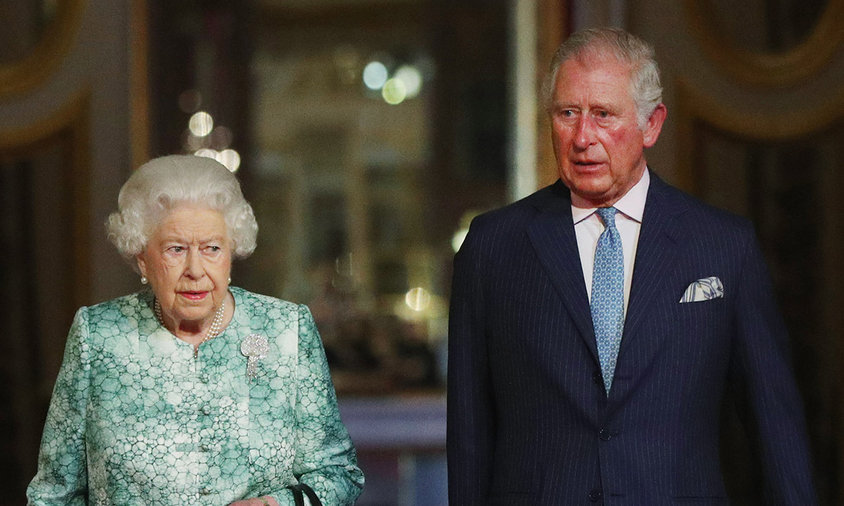 the queen and prince charles looking sombre