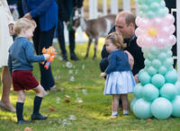 Prince George playing with bubble gun