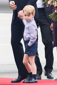 Prince George pouting at airport