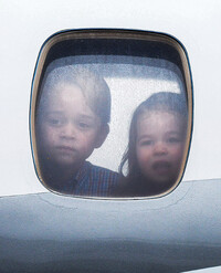 Prince George and Princess Charlotte looking through window