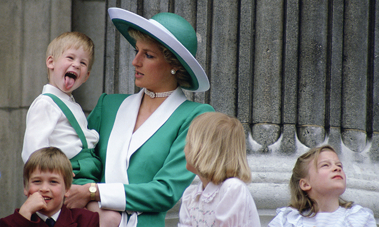 Prince Harry sticking his tongue out much to the surprise of his mother, Princess Diana, at Trooping The Colour with  Prince William, Lady Gabriella Windsor and Lady Rose Windsor on the balcony of Buckingham Palace    (Photo by Tim Graham/Getty Images)