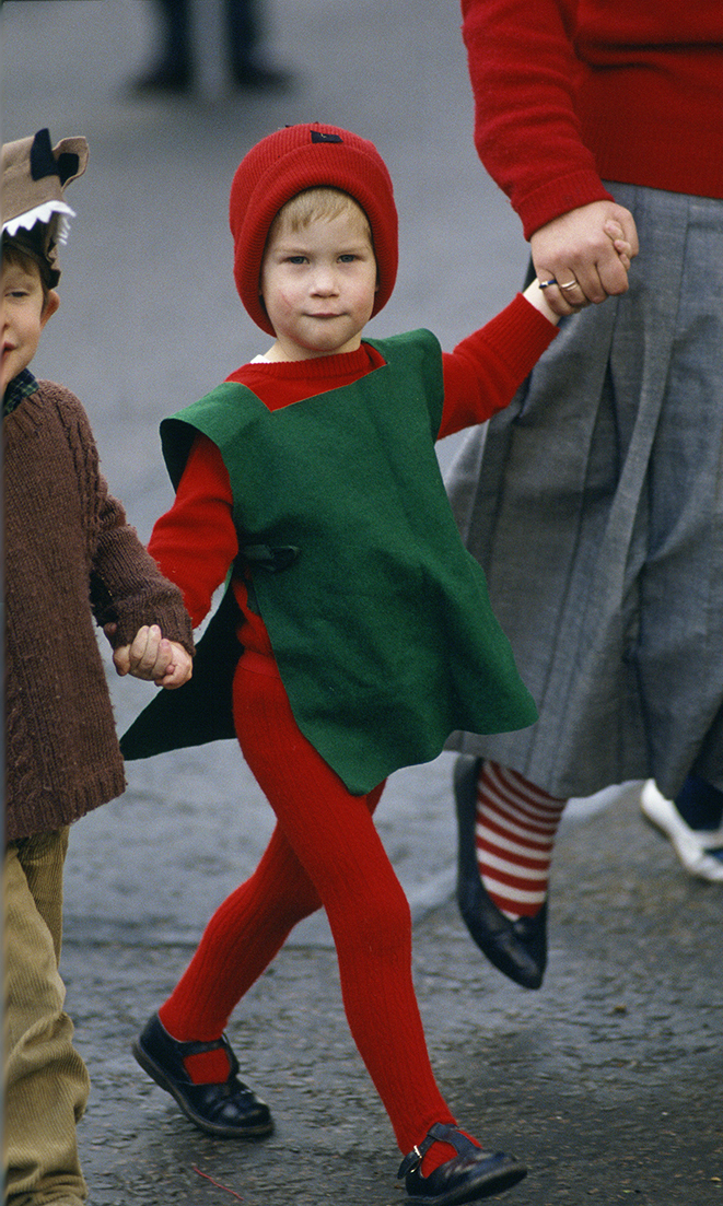 Prince Harry dressed in a red goblin costume setting off to take part in his nursery school's Nativity play.    (Photo by Tim Graham/Getty Images)