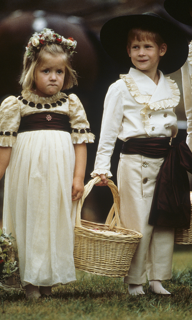 Prince Harry enjoys his role as a pageboy alongside his cousin Eleanor Fellowes at the wedding of his uncle, Viscount Althorp, to Victoria Lockwood on September 17, 1989 in Althorp, England.     (Photo by Georges DeKeerle/Getty Images)
