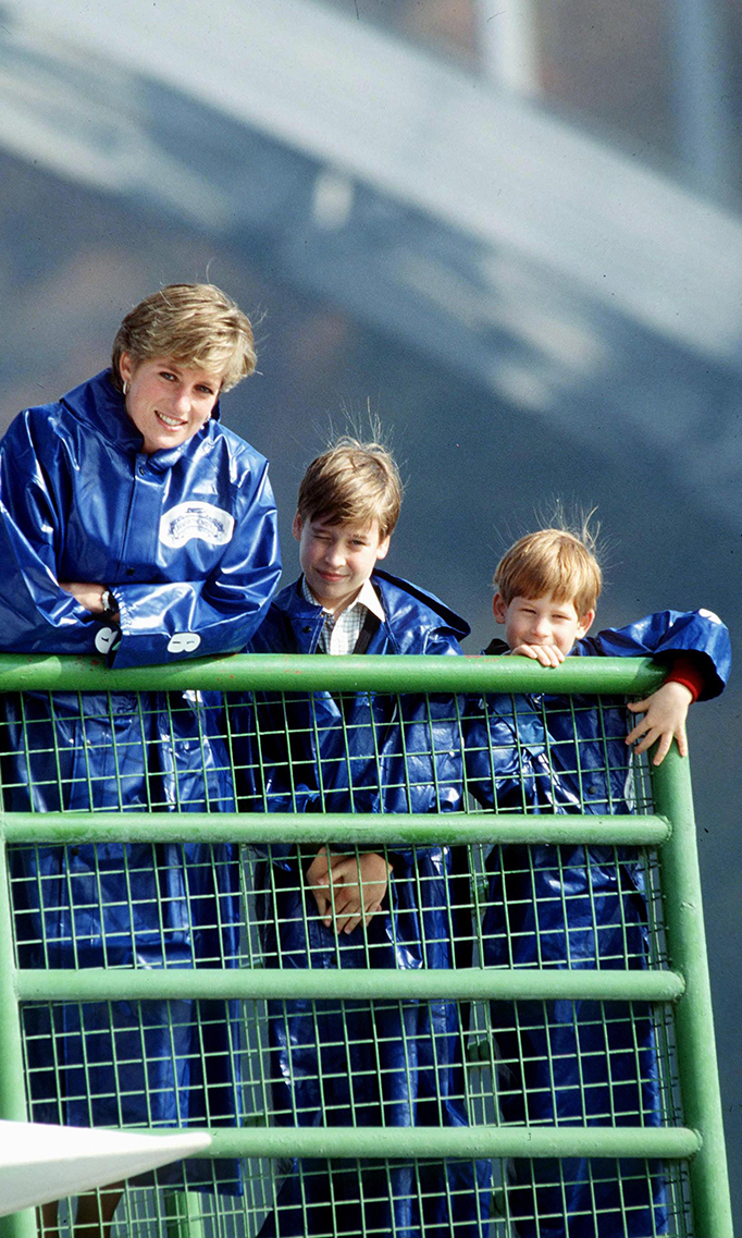 Princess Diana, Prince William and Prince Harry in waterproof capes on The Maid of the Mist during a trip to Canada's Niagara Falls    (Photo by Tim Graham/Getty Images)