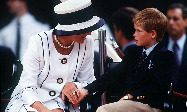Princess Diana holding Prince Harry's hand whilst watching the Parade of Veterans on  V J Day on The Mall in London.    (Photo by Tim Graham/Getty Images)