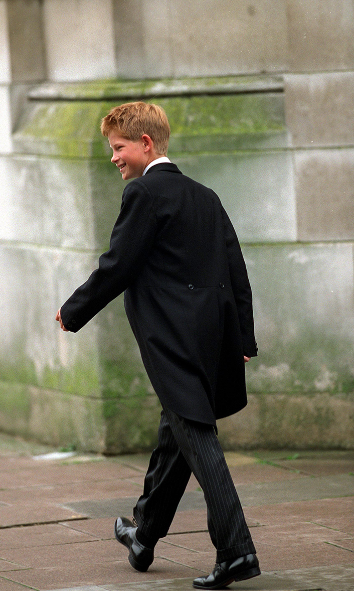 Prince Harry leaves his school house for his first day of lessons at Eton College.  He is wearing the traditional Eton Tail Coat.    (Photo by Tim Graham/Getty Images)
