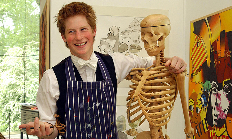 Prince Harry, a keen artist , poses  next to a skeleton in Eton College's Drawing School