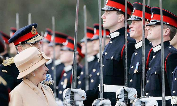 Queen Elizabeth II as proud grandmother smiles at Prince Harry as she inspects soldiers at their passing-out Sovereign's Parade at Sandhurst Military Academy in Surrey, England.   (Photo by Tim Graham/Getty Images)