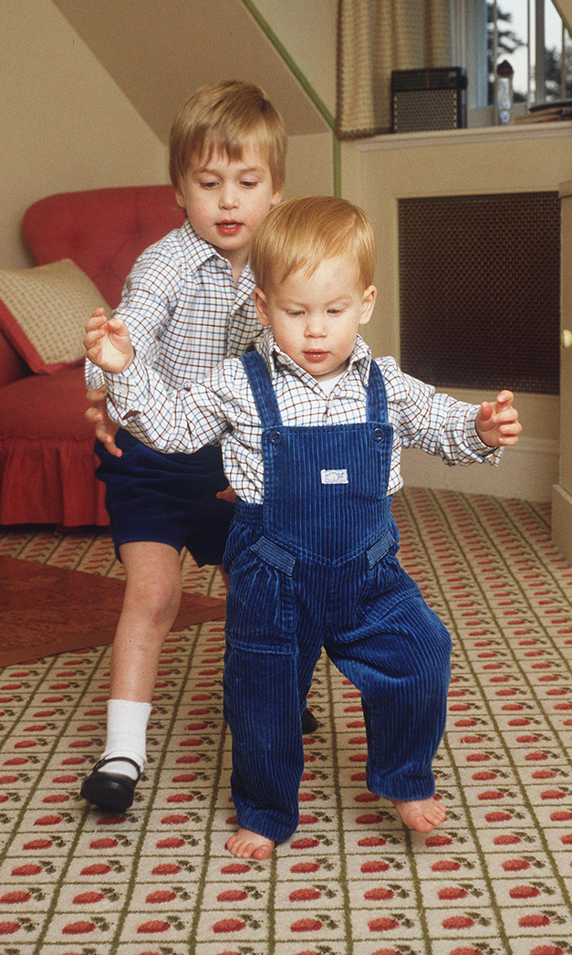 In the playroom at home In Kensington Palace Prince Harry takes his first steps helped by his brother Prince William    (Photo by Tim Graham/Getty Images)