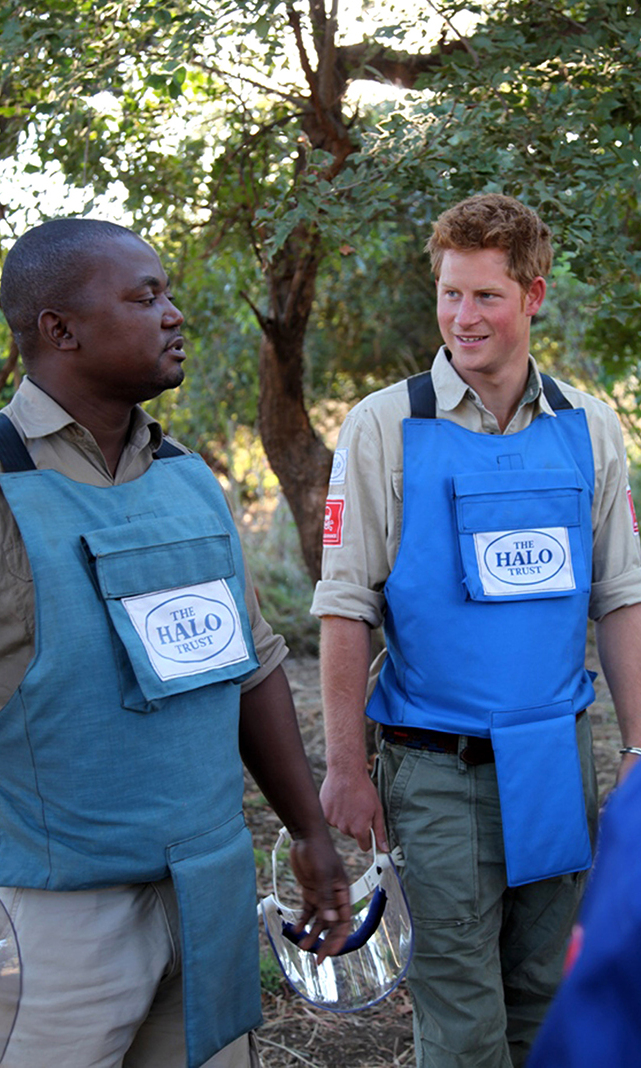Prince Harry with deminers from The HALO Trust, a British charity dedicated to the removal of landmines, in Cahora Bassa, Mozambique. Prince Harry is following in his late mother's footsteps. Princess Diana visited the same charity in Angola eight months before her death.   Photo by The HALO Trust/Getty Images