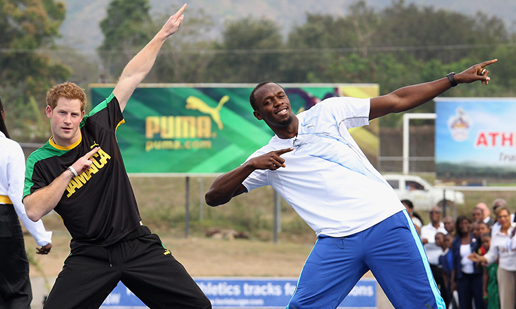 Prince Harry poses with Usain Bolt at the Usain Bolt Track in Kingston, Jamaica. Prince Harry was in Jamaica as part of a Diamond Jubilee Tour representing his grandmother Queen Elizabeth II.   (Photo by Chris Jackson/Getty Images)