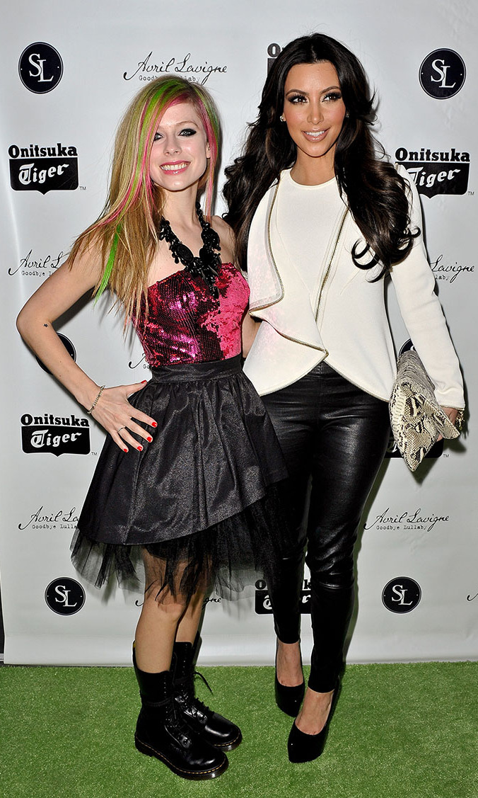 "Hanging out with pal Kim Kardashian at the record release party for ""Goodbye Lullaby"" in 2011, Avril showed off her signature style in a black tutu and Doc Marten boots."