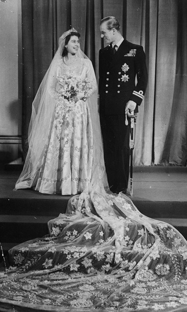 Princess Elizabeth and Prince Philip are pictured at Buckingham Palace after their wedding at Westminster Abbey in 1947.