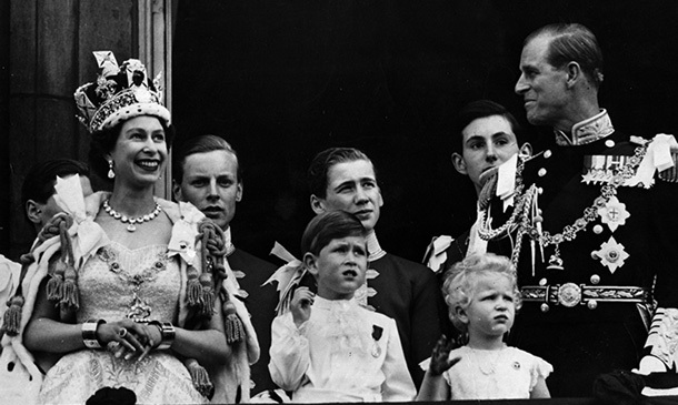 Queen Elizabeth is seen on the balcony of Buckingham Palace after her coronation ceremony in 1952 with (left to right) Prince Charles, Princess Anne and her beloved husband, Prince Philip.