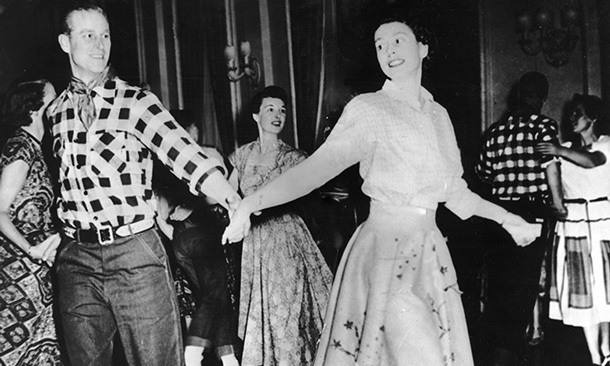 The Duke of Edinburgh dances with his wife at a square dance held in their honour in Ottawa on Oct. 17, 1951.