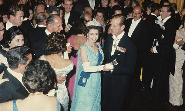 Queen Elizabeth and Prince Philip dance at a state ball during a Commonwealth tour to Malta in 1967.