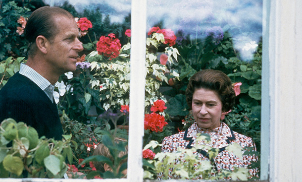 In 1972, Queen Elizabeth and Prince Philip visit a greenhouse at Balmoral in Scotland.