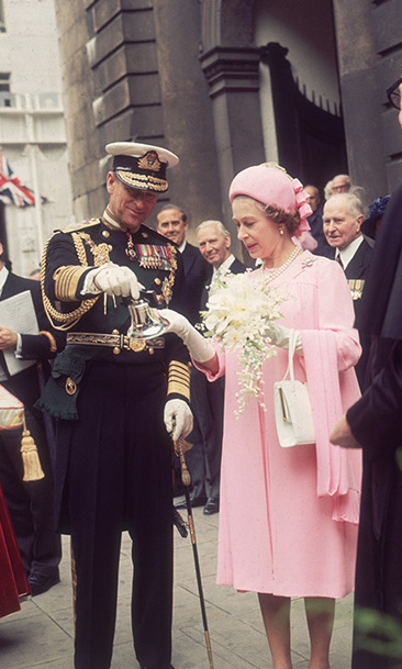 The Queen and Prince Philip admire a silver bell on the occasion of her Silver Jubilee in 1977.