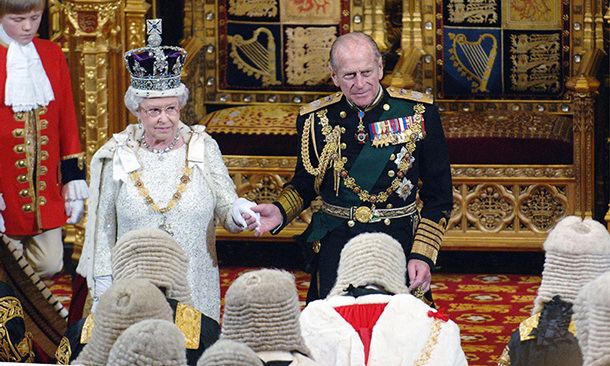 Queen Elizabeth and Prince Philip join hands at the State Opening of Parliament on Nov. 15, 2006, in London.