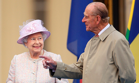 Queen Elizabeth and Prince Philip attend the launch of the Queen's Baton Relay at Buckingham Palace on Oct. 9, 2013.