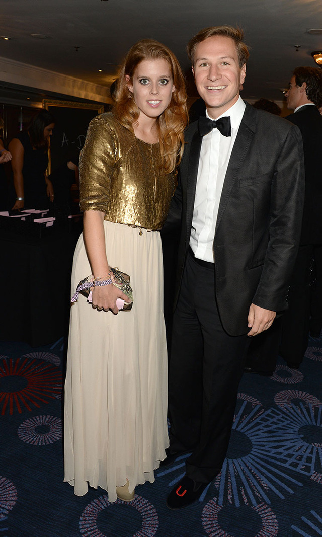 The 2013 Boodles Boxing Ball in London may have taken place a few months before the holidays, but we think Princess Beatrice's cropped, metallic jacket would offer a festive upgrade to any cocktail dress. Here, she poses with her boyfriend Dave Clark.