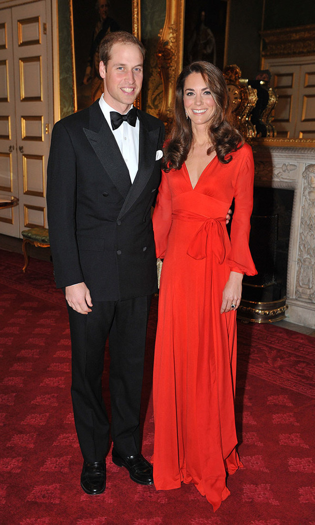 Lady in red! Still newlyweds in Sept. 2011, the Duke and Duchess of Cambridge look overjoyed attending a fundraising gala in London - and Kate's rosy cheeks are perfectly coordinated with her jolly red maxi dress. We love those billowing sleeves, perfect for battling that Christmas frost!