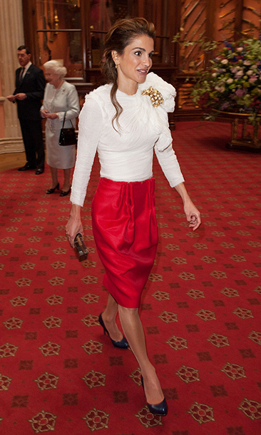 Queen Rania of Jordan was voted the world's most beautiful consort in 2011, and she's always had style to boot. She chose this red-and-white ensemble for a luncheon at Windsor Castle in 2012, but the colour scheme of red, gold and winter white screams holiday shindig.