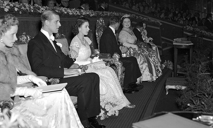 King George VI and Queen Elizabeth with Princess Elizabeth and Philip, Duke of Edinburgh in the Royal Box at The Odeon, Leicester Square, London at a film premiere of 'Hamlet', May 6, 1948.