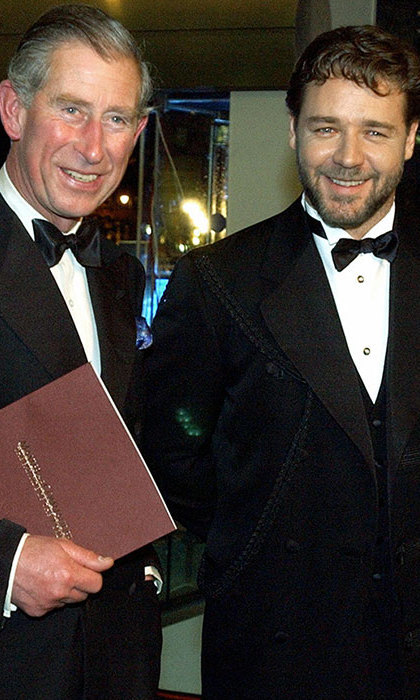 Prince Charles poses with New Zealand-born actor Russell Crowe at the Royal Premiere of 'Master and Commander: The Far Side of the World,' screened at a London cinema, November 17, 2003.
