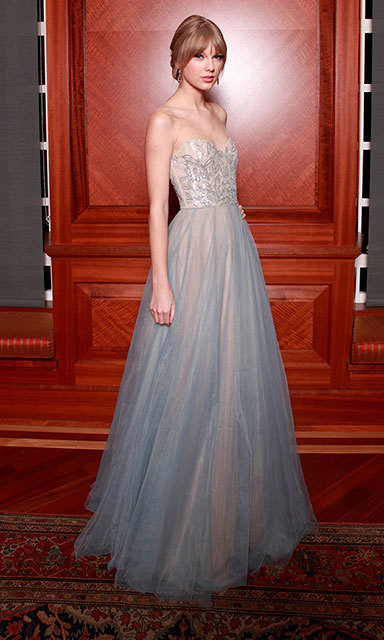 "This is classic ""Taylor Swift"" at its best: For the annual Nashville Symphony Ball in 2011, she chose a dreamy, pale-blue gown with tulle by Reem Acra."