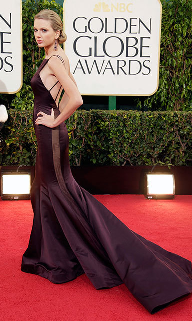 Taylor held her own on the red carpet in an eggplant Donna Karan Atelier gown for the 2013 Golden Globes, which she paired with showstopping Lorraine Shwartz earrings.