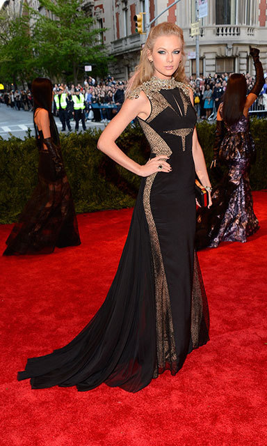 "Taylor put a ""punk"" spin on haute couture in a J Mendel gown at the 2013 Costume Institute Gala, topping it off with tousled locks and loads of black eyeliner."
