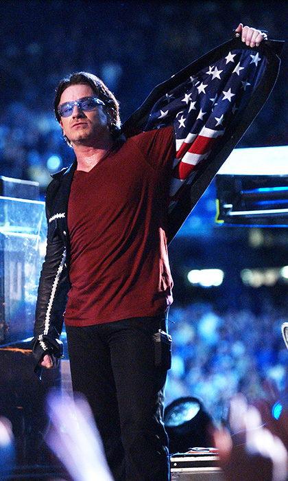 "It was the first Super Bowl since Sept. 11, and Bono paid his respects by displaying the American flag lining in his jacket after singing ""Where The Streets Have No Name."" A projection screen also showed the names of all the victims of 9/11."