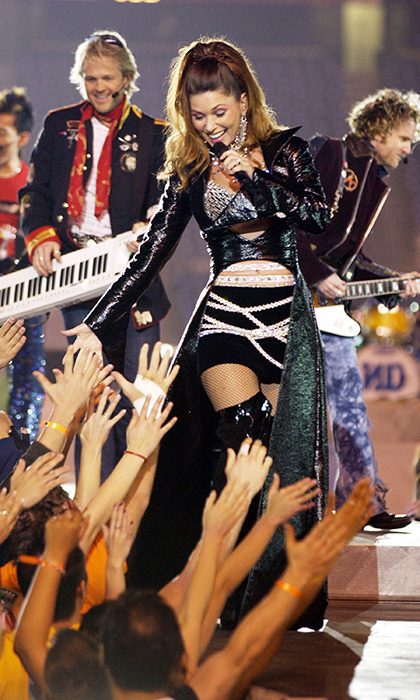 "In 2003, Shania Twain took the Super Bowl stage in San Diego, California to sing two songs, ""Man I Feel Like a Woman!"" and ""Up!"" before No Doubt performed ""I'm Just a Girl"" and Sting played ""Message in a Bottle."" The Canadian country sensation had just released her album 'Up!' two months earlier."