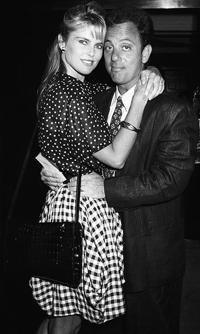 Christie and Billy Joel embraced at Langan's Brasserie in London on July 4, 1987. The pair were wed in 1985 and split up in 1994.