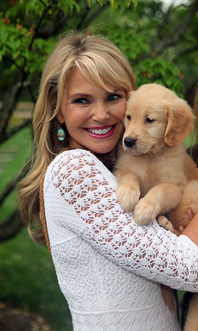 Who is cuter? The model hugged a rescue puppy as she accepted the Humanitarian of the Year award from the Pet Philanthropy Circle on June 29, 2013.